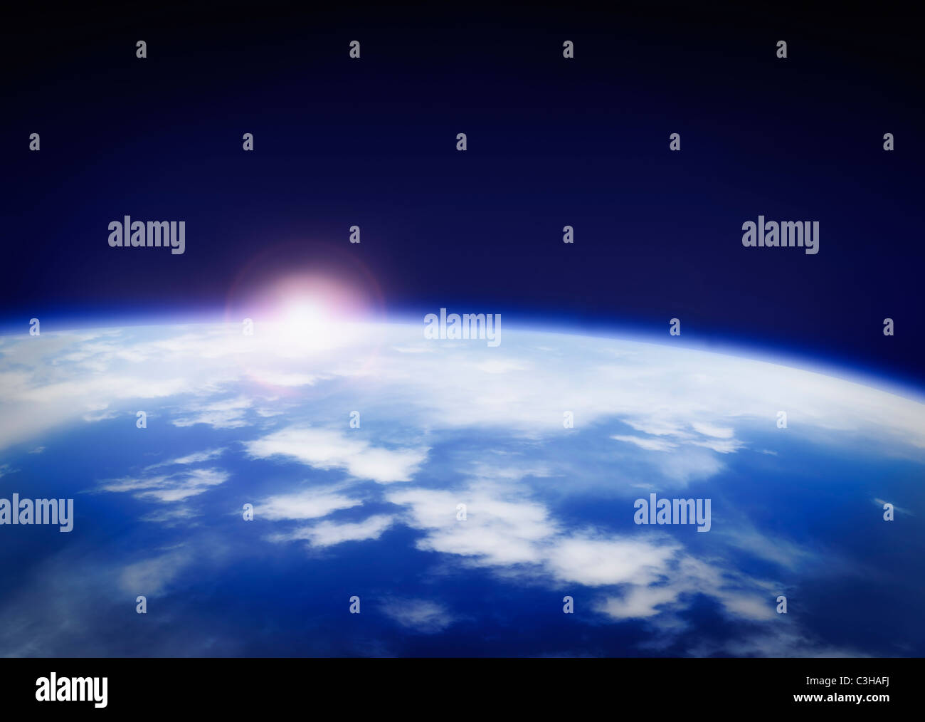 Space with rising sun above planet earth - Stock Image
