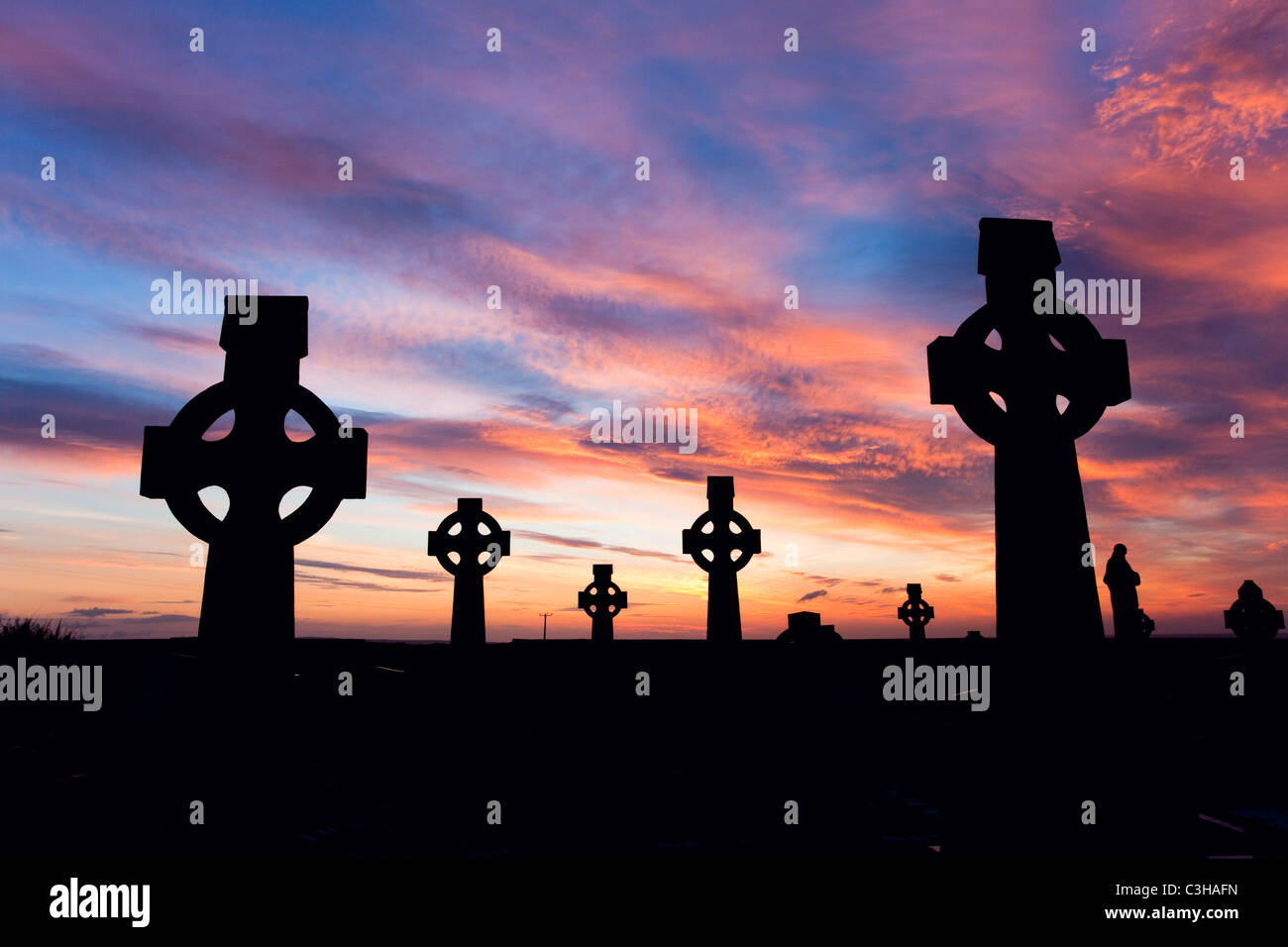 Celtic crosses in a cemetery at sunset, Enniscrone, County Sligo, Ireland. - Stock Image