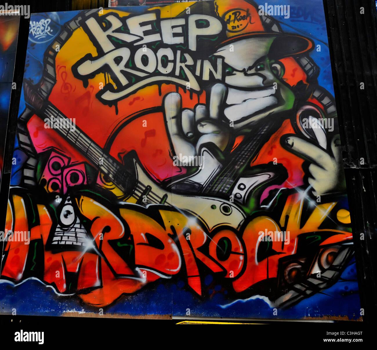 Hard rock cafe graffiti on the wall expressionism and social messaging weird and bizarre art bangkok thailand