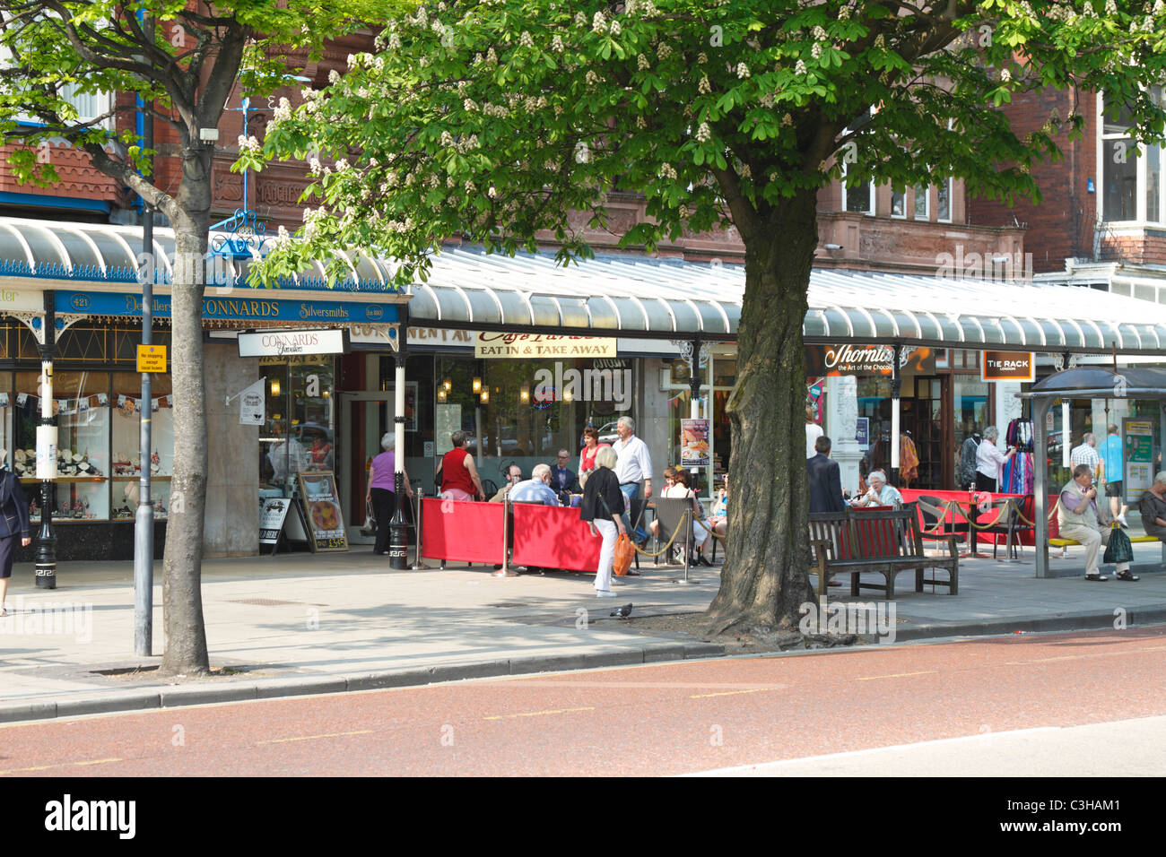 Pavement cafe on tree lined Lord Street in Southport, Merseyside, Lancashire, England, UK. Stock Photo
