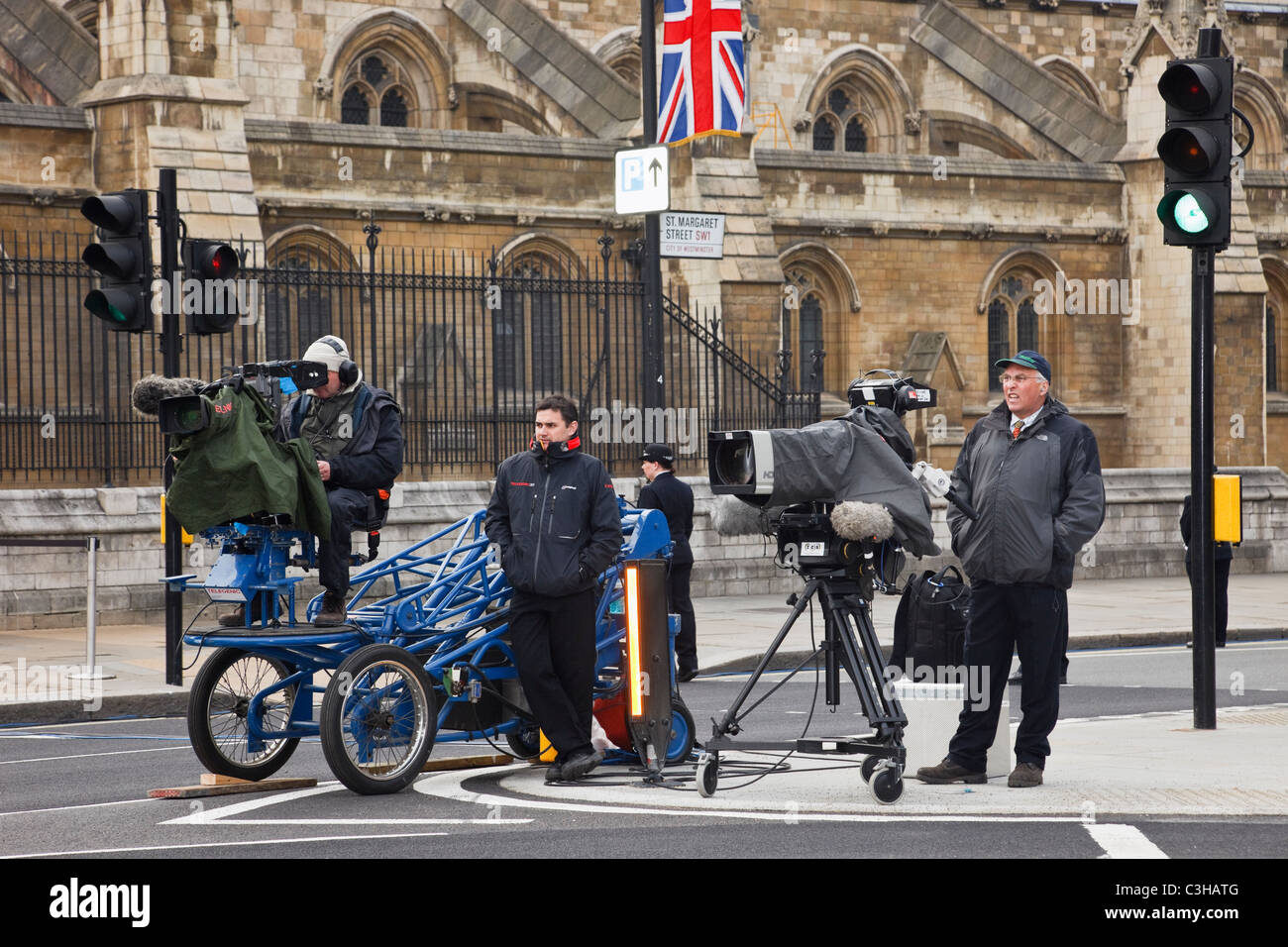 Parliament Square, City of Westminster, London, England, UK. TV film crew cameramen in street filming on Royal Wedding - Stock Image