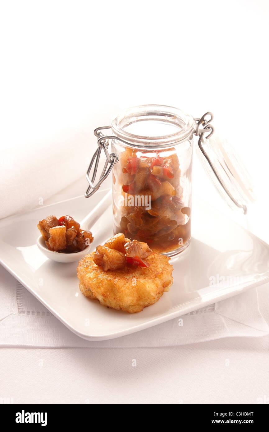 Potato latka with chutney - Stock Image