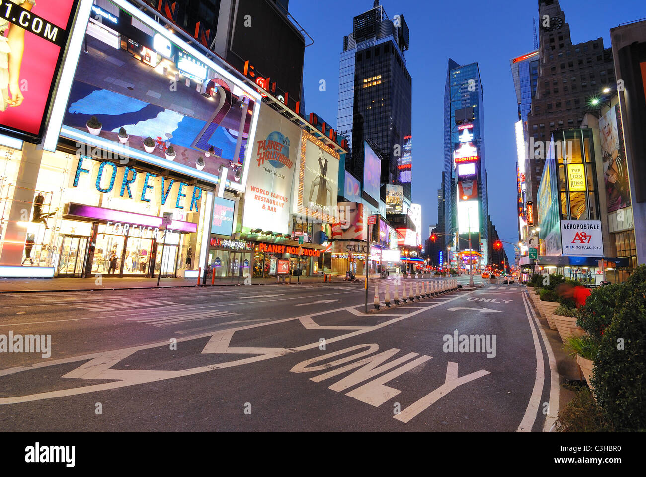 Storefronts and advertisements in an unusually empty Times Square New York City at dawn. Stock Photo