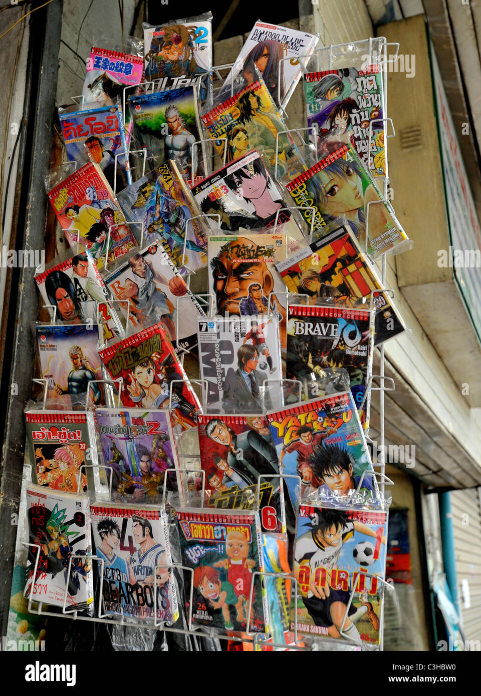 chinese , thai and american comic books for sale, chinatown, bangkok, thailand - Stock Image