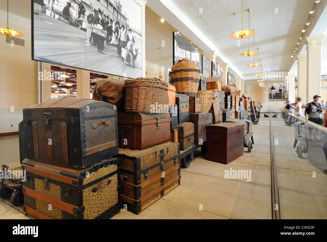 Actual vintage luggage left by immigrants at the Ellis Island Museum in New York City. - Stock Image