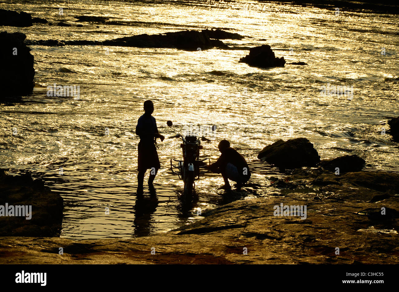 Democratic Republic of Congo in January 2011.Washin motorbike in Epulu river - Stock Image
