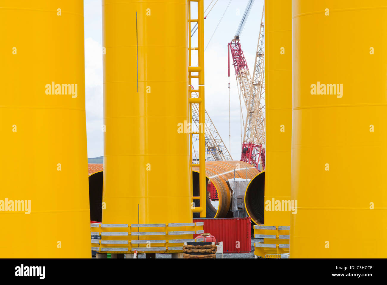 Transition pieces destined for the Walney offshore wind farm in Barrow in Furness, UK. - Stock Image