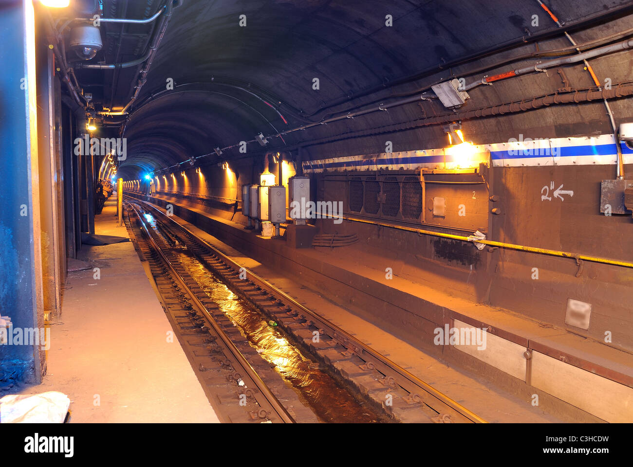 Looking down a Subway tunnel below New York City. - Stock Image