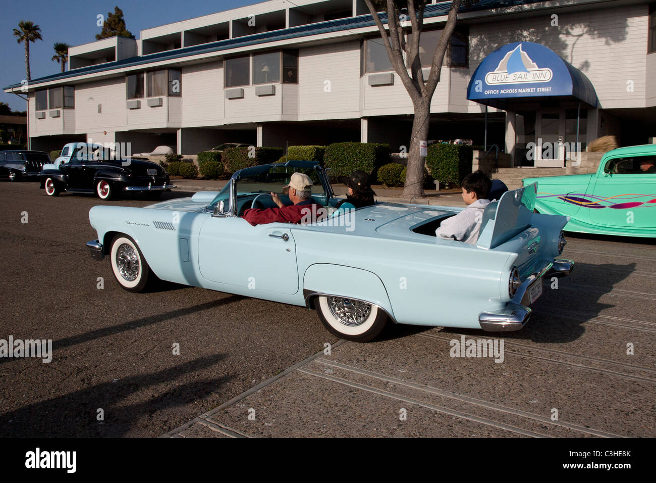 People Riding in the Rumble Seat of a Ford Thunderbird Stock Photo