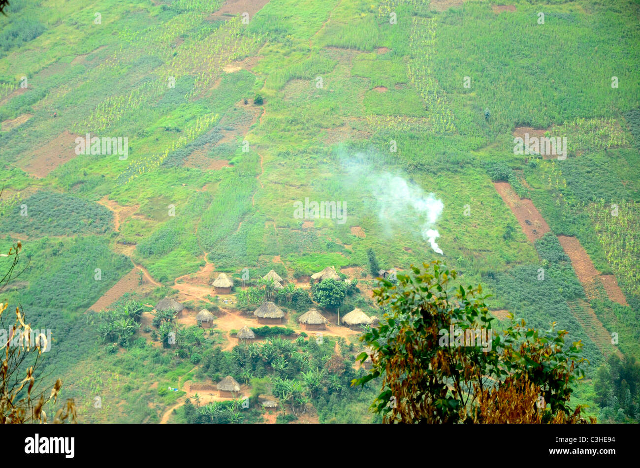 African huts and farmlands in highlands of eastern Democratic Republic of Congo in January 2011. Stock Photo