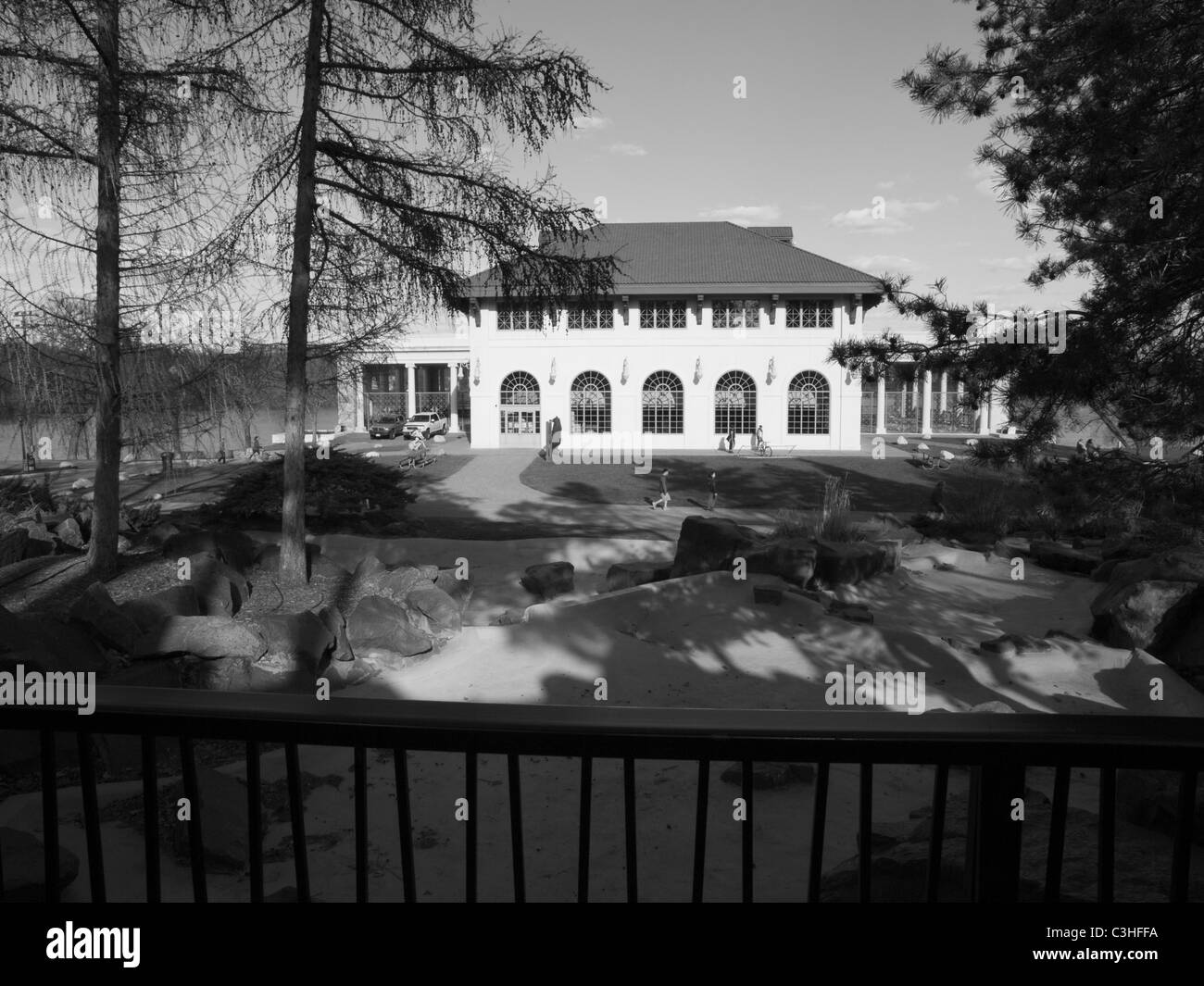 view of Lake Como pavilion from Hamm Memorial water fall in Como Park, St. Paul, MN, USA - Stock Image