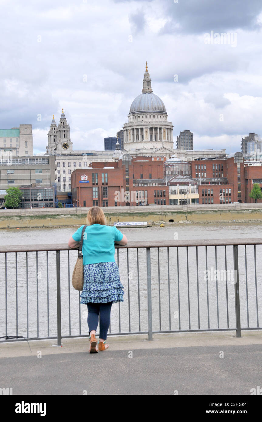 Woman staring at St Pauls Cathedral contemplation quiet solitude calm peaceful depressed alone lonely woman - Stock Image