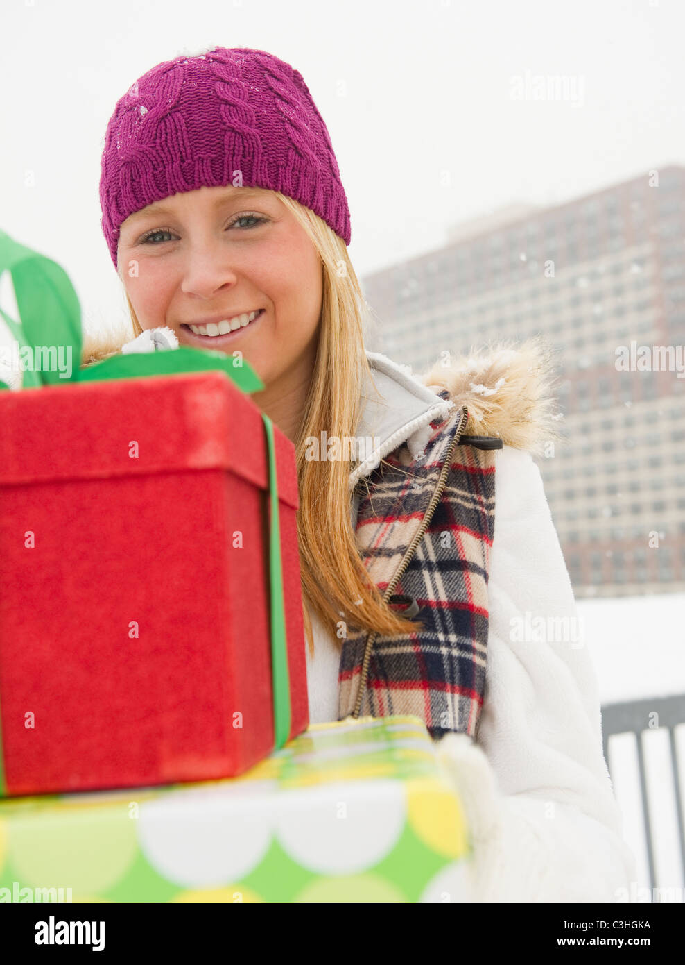 Woman holding christmas gifts - Stock Image