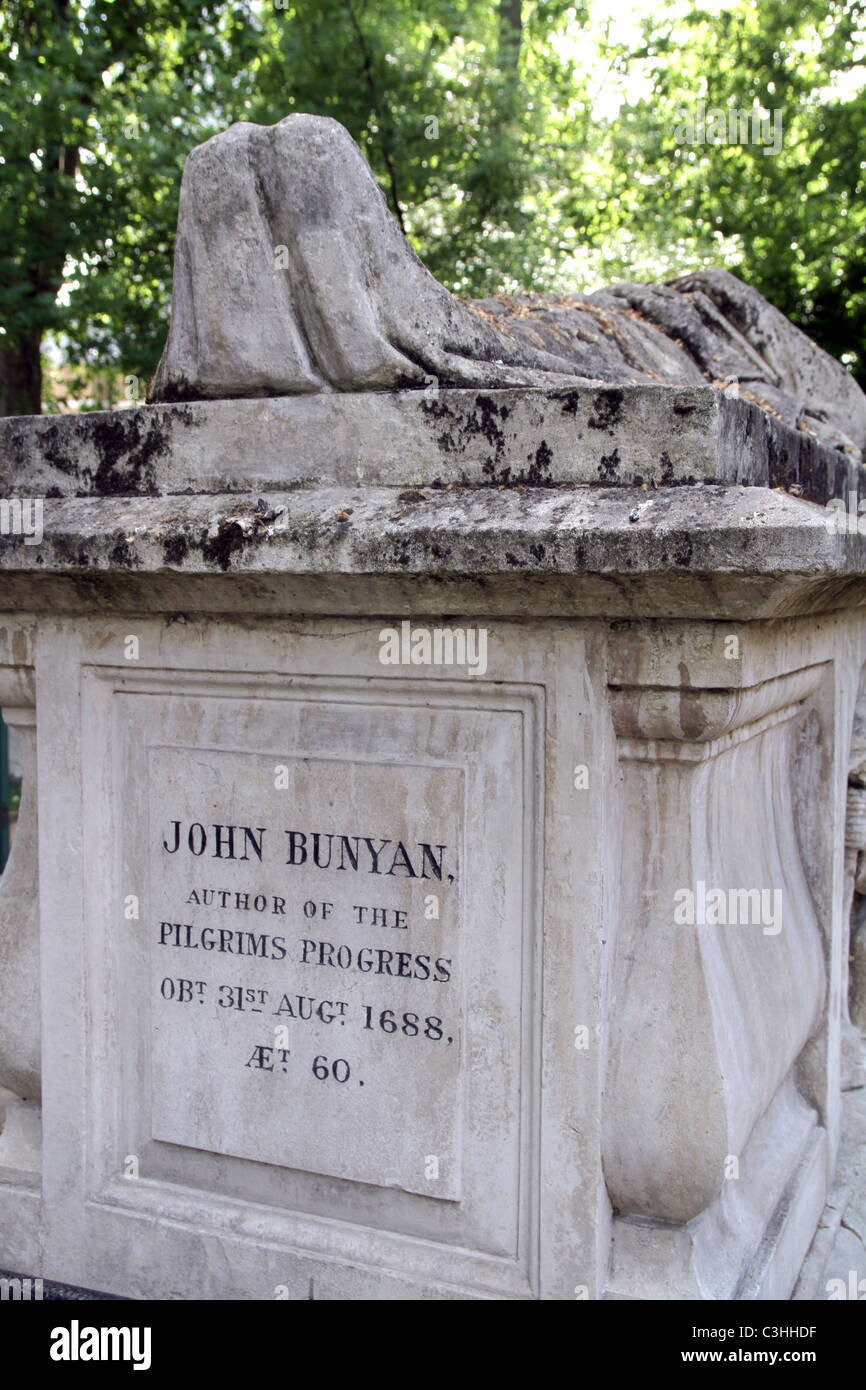 Gravestone of John Bunyan at Bunhill Fields Burial Ground in the City of London - Stock Image