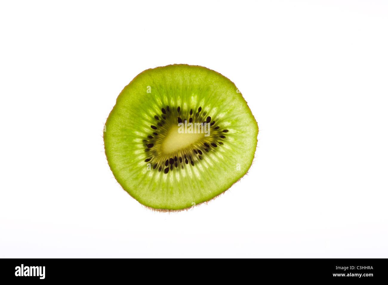 Kiwi slice on white - Stock Image
