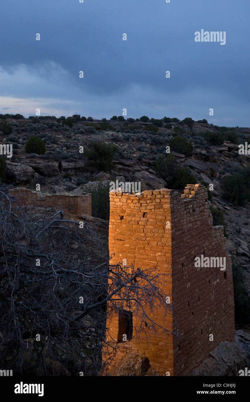 Ancestral Puebloan Holly Tower sits on tall, narrow boulder at dusk in Hovenweep National Monument in southern Utah, Stock Photo