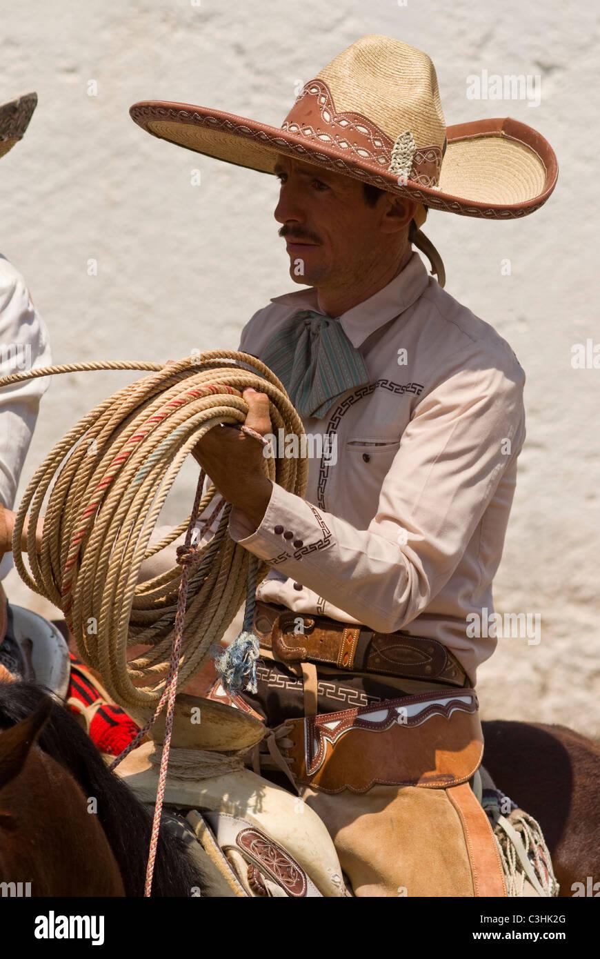 Mexico charros mexican cowboy stock photos mexico charros mexican jpg  870x1390 Mexican cowboy sombrero 88eb1d7c387