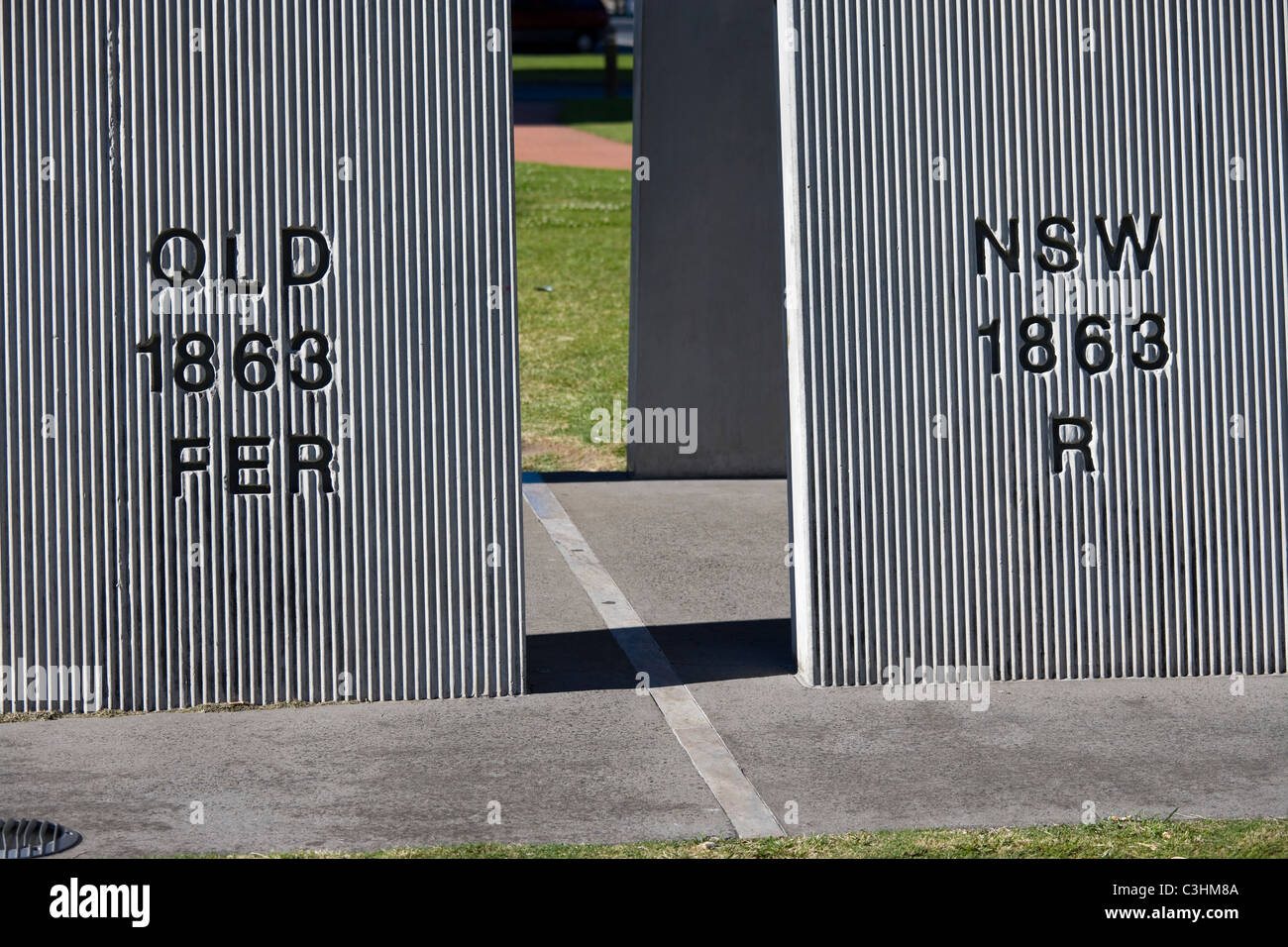Border marker between two states Queensland and New South Wales. Dividing twin cities Coolangatta and Tweed Heads. - Stock Image