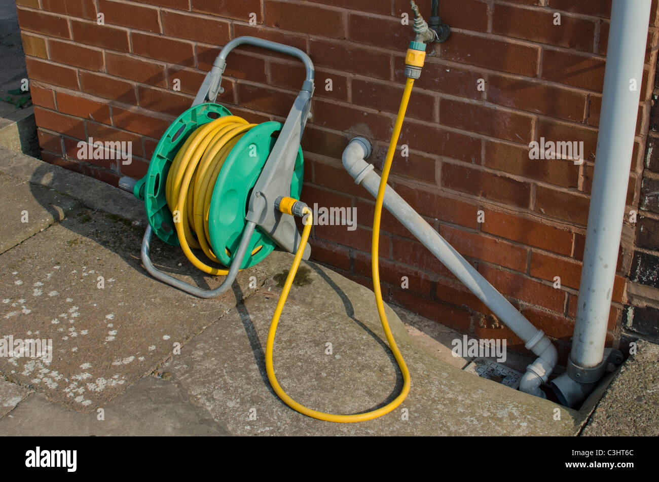 Coiled Yellow Water Hose Stock Photos & Coiled Yellow Water Hose ...