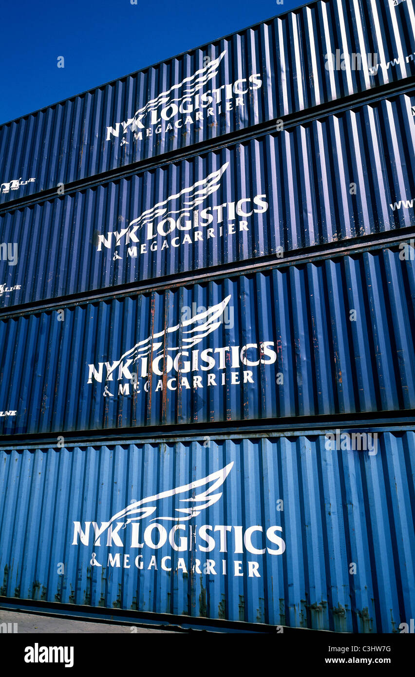 Stack of NYK Logistics intermodal containers in the port of Hamburg. - Stock Image