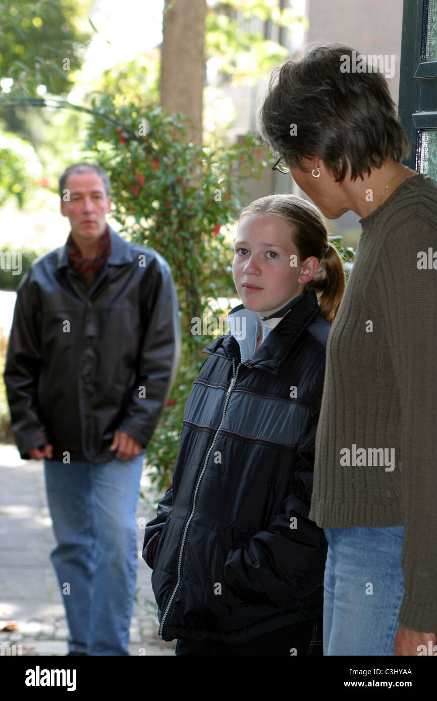Shared Child Custody: Divorced dad picking up unhappy child for weekend visitation after divorce. - Stock Image