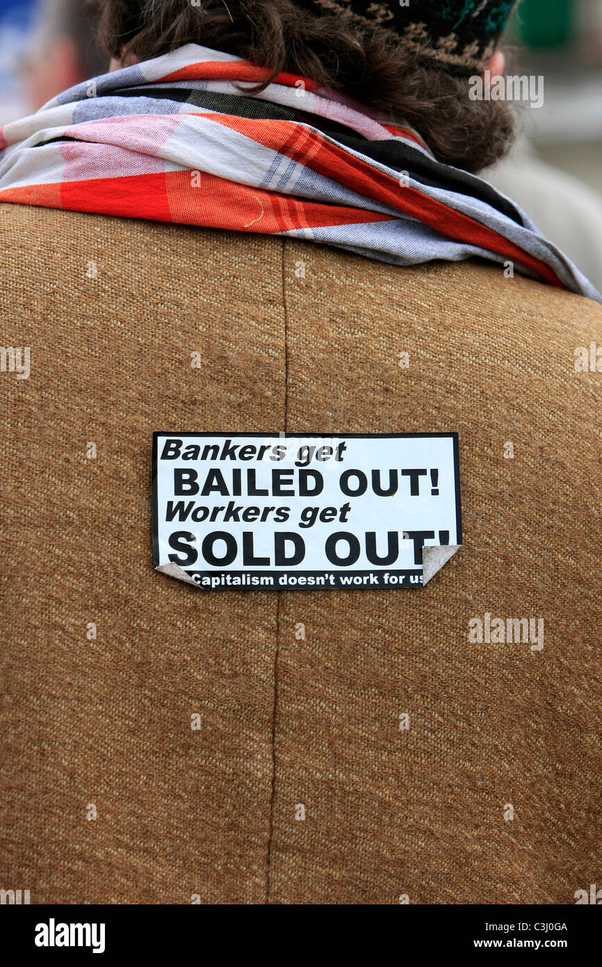 Anti- Banker sticker on the back of an AFL protester in Weymouth Dorset - Stock Image