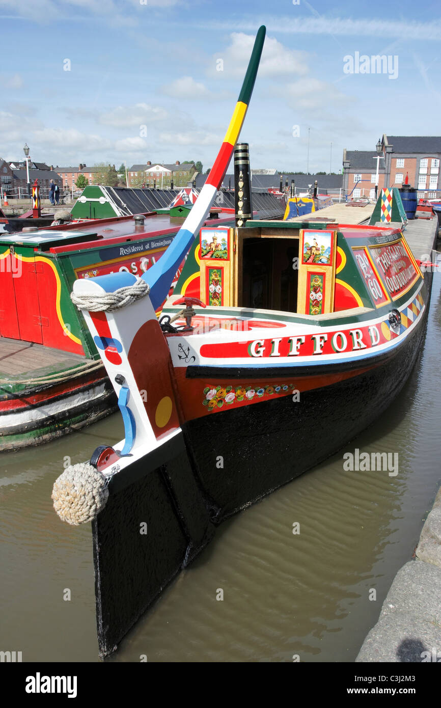 Brightly painted canal narrow boats moored at the National Waterways Museum at Ellesmere Port in Cheshire - Stock Image