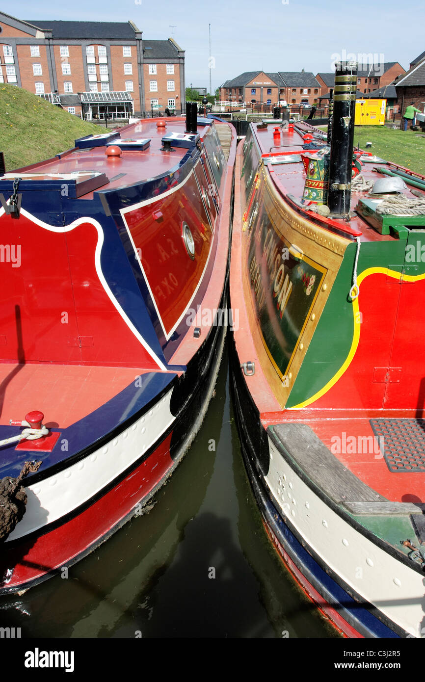 canal narrow boats moored side by side at the National Waterways Museum at Ellesmere Port in Cheshire - Stock Image