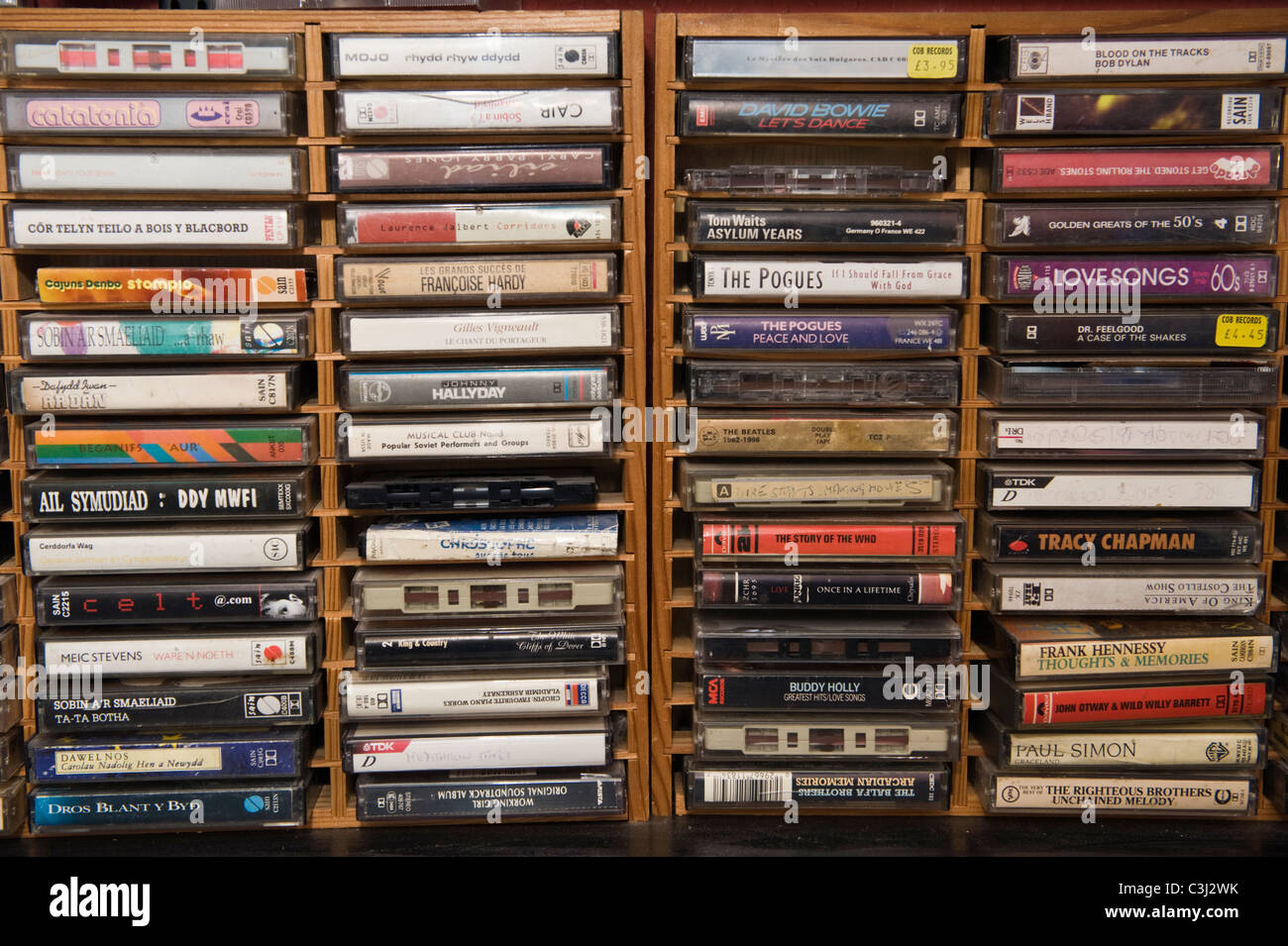Music cassette tapes organized in wooden rack - Stock Image