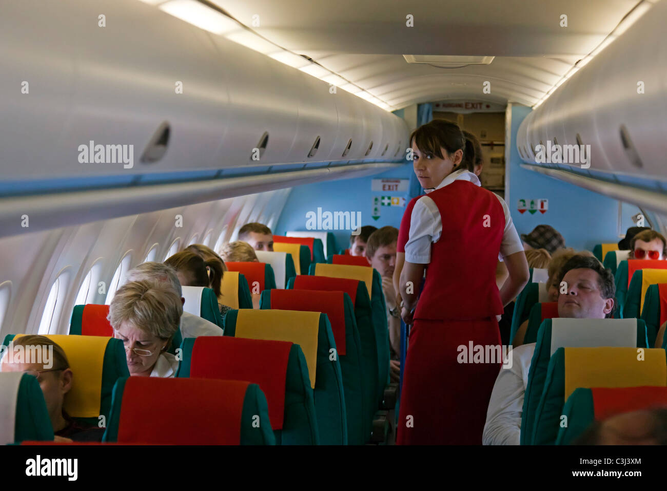 Flight attendant and passengers, Austrian Airlines - Stock Image