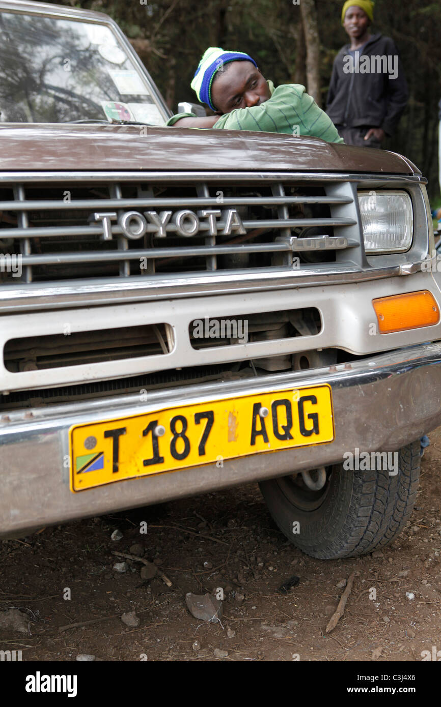 yellow licence plate on a Toyota Landcruiser in Tanzania. - Stock Image