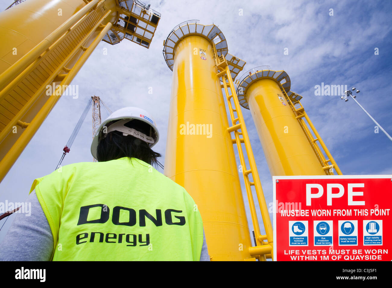 Transition pieces destined for the Walney offshore windfarm in Barrow in Furness, Cumbria, UK. - Stock Image