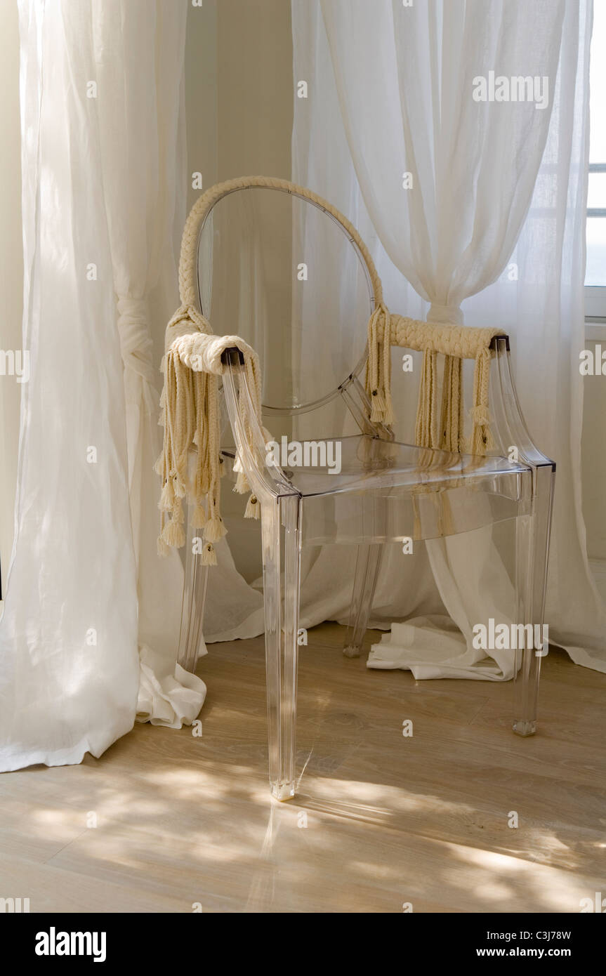 Philippe Starck Louis Ghost chair with detail by Isabel Marant Stock ...