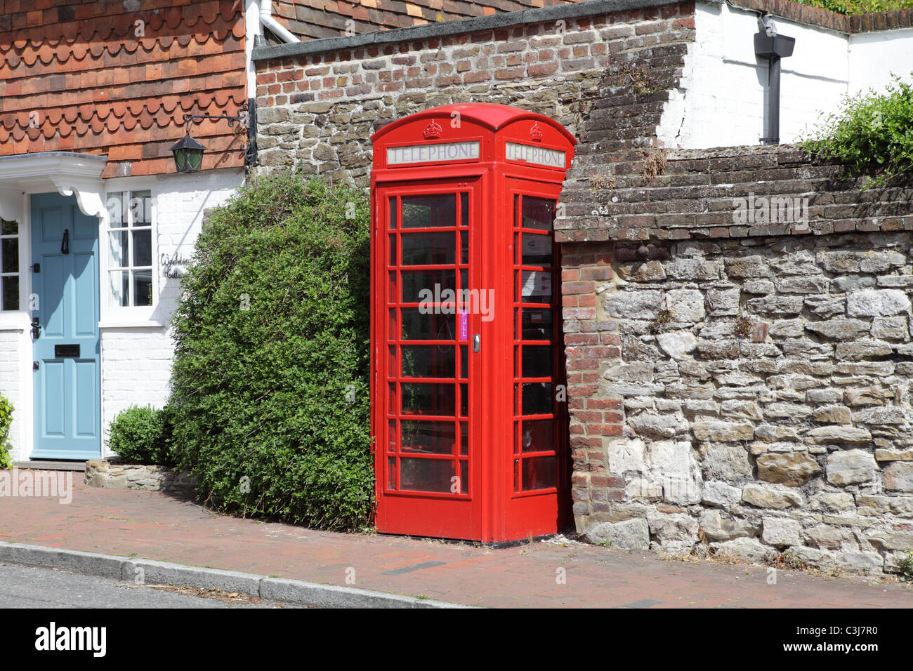 Traditional red telephone box,Winchelsea, East Sussex, UK - Stock Image