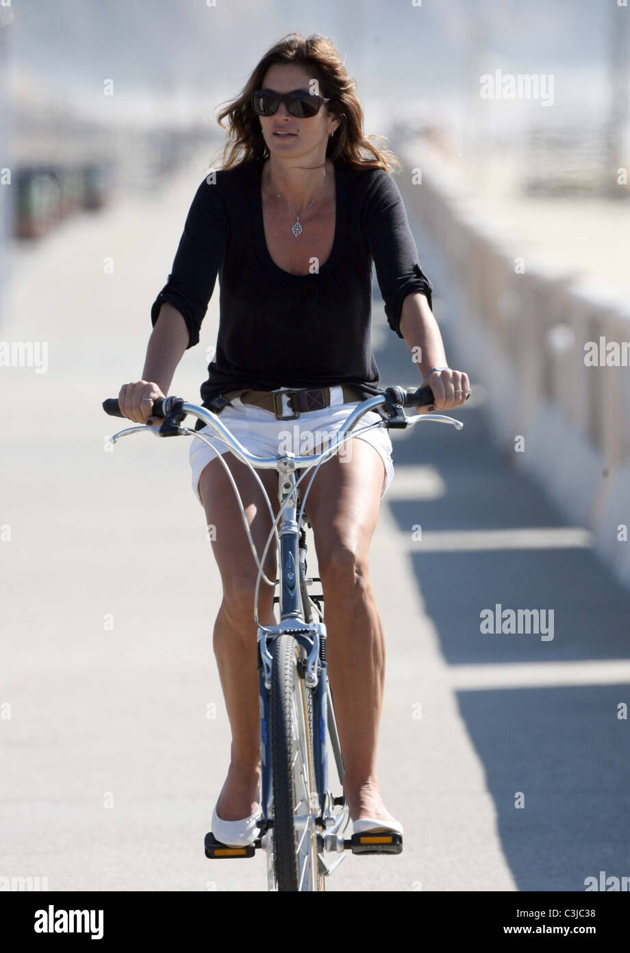 84a7b98cd48 Cindy Crawford taking a family bicycle ride in Malibu with her husband and  daughter Los Angeles