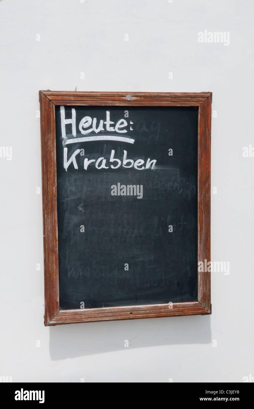 Germany, Northsea, Amrum, Heute krabben text on blackboard - Stock Image