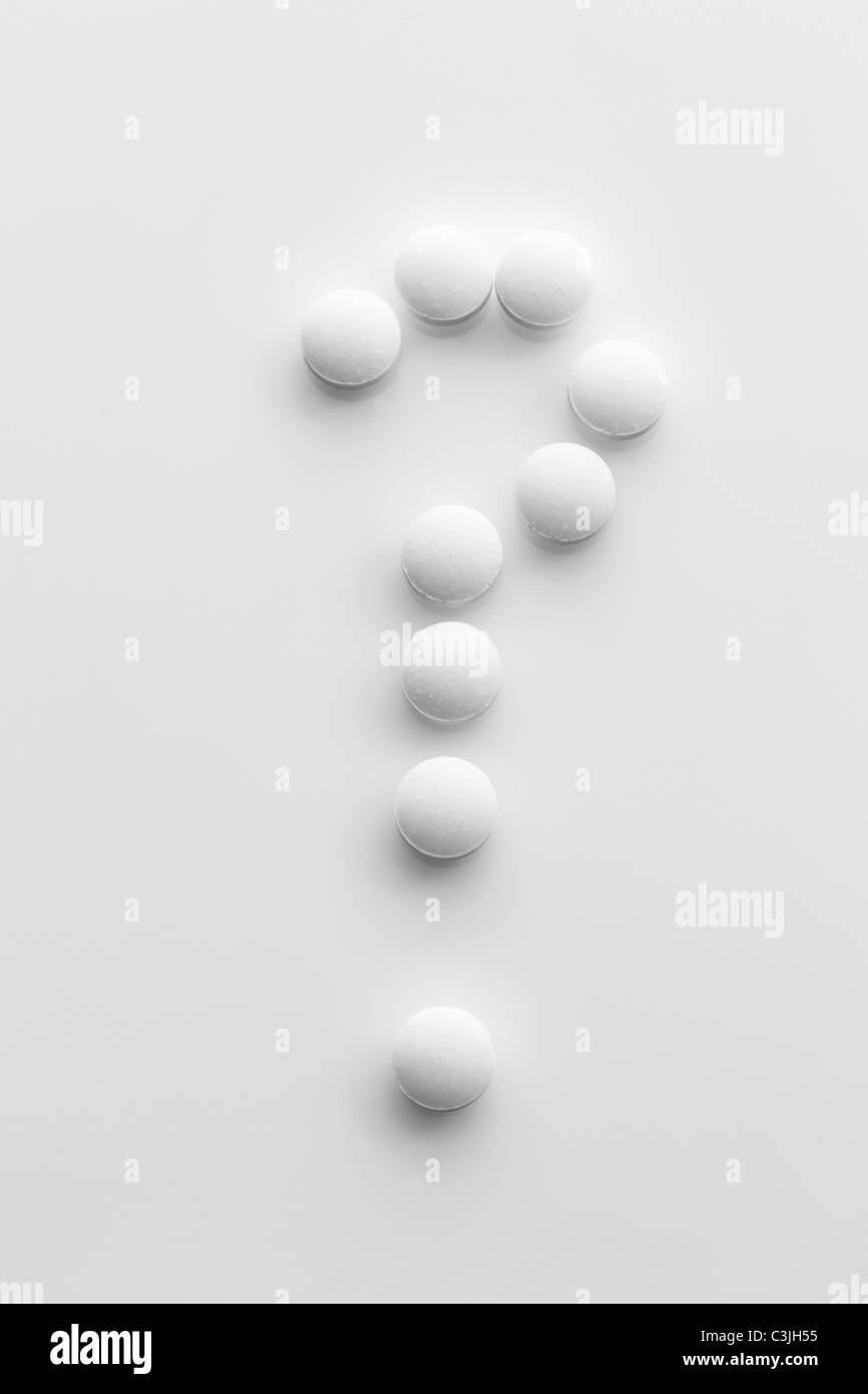 Tablets forming a question mark - Stock Image