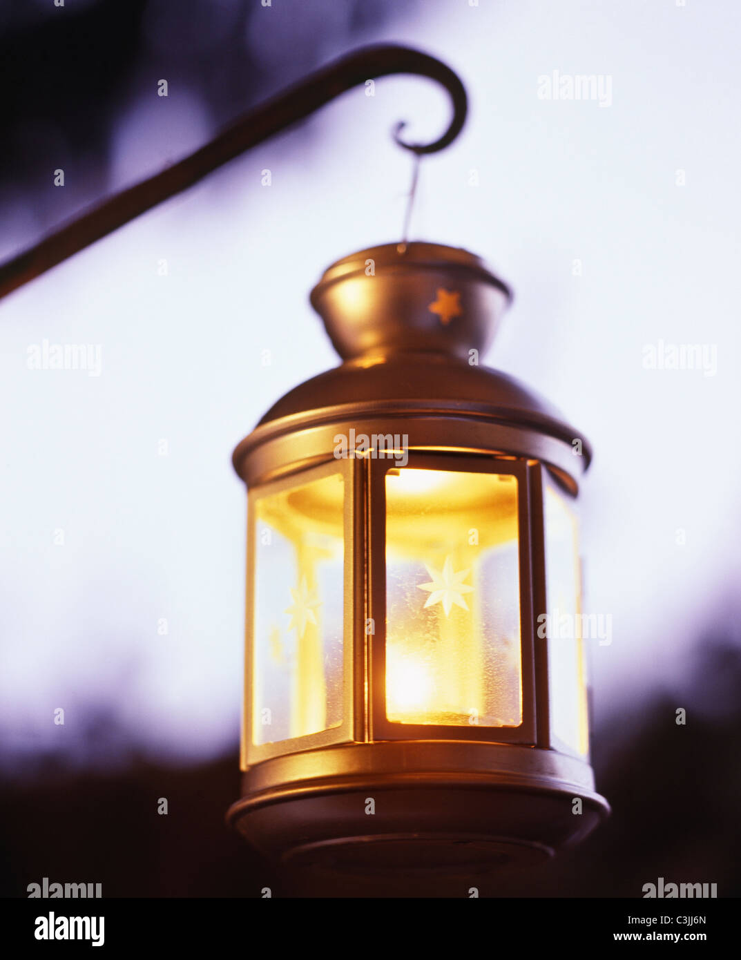 Lantern with candle at twilight. - Stock Image