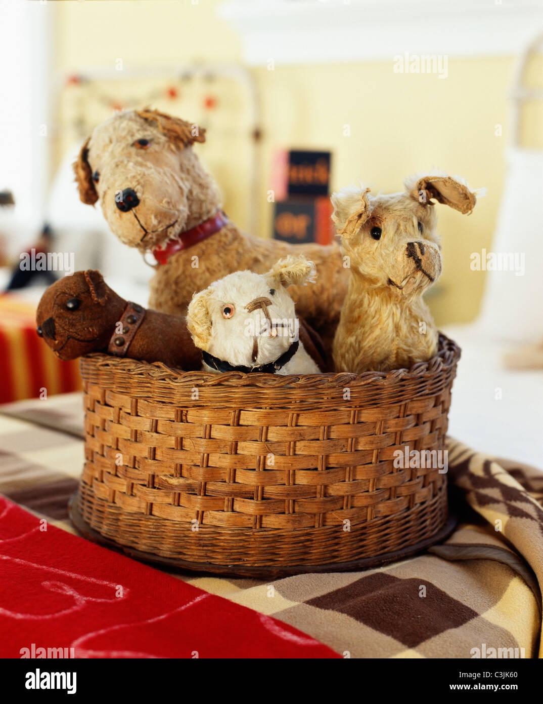 Basket of vintage stuffed animals. - Stock Image