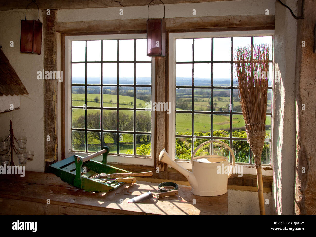 Wooden potting shed with view through metal framed windows,with ...