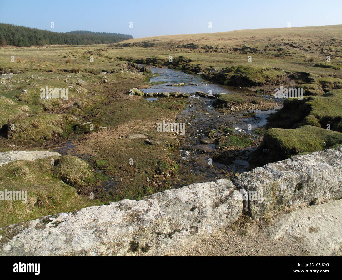 Moorland stream running at the base of Roughtor on Bodmin Moor on a fine early spring day, Cornwall - Stock Image