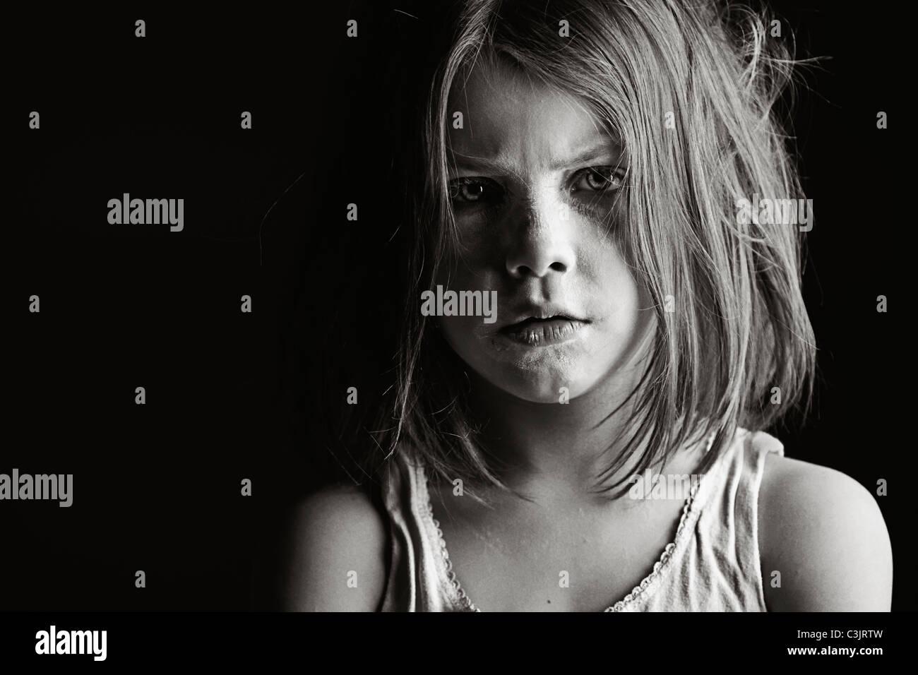 Studio portrait of serious girl (6-7) - Stock Image