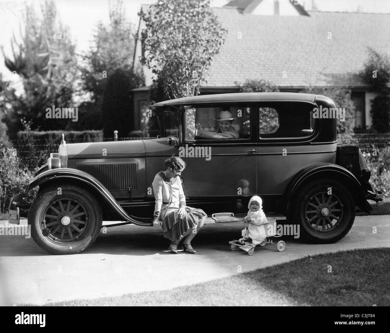 Stan Laurel in his 1927 Hupmobile. daughter Lois and wife also called Lois on running board. - Stock Image