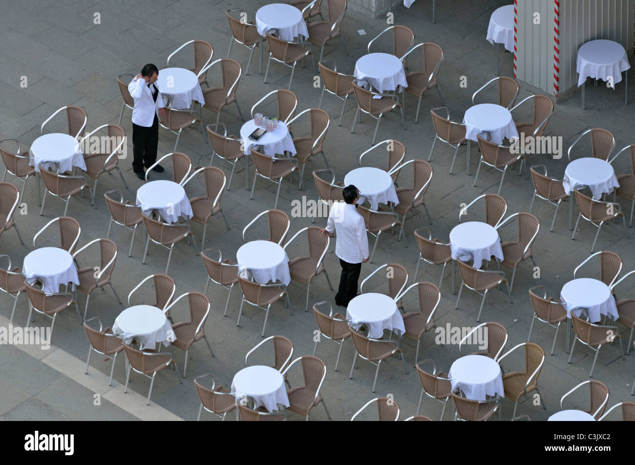 Waiters at empty cafe - Stock Image