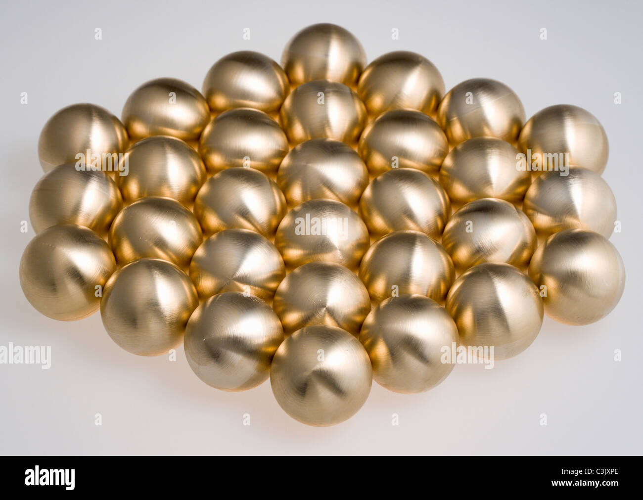 Hexagon shape is made using ball bearing on white background - Stock Image
