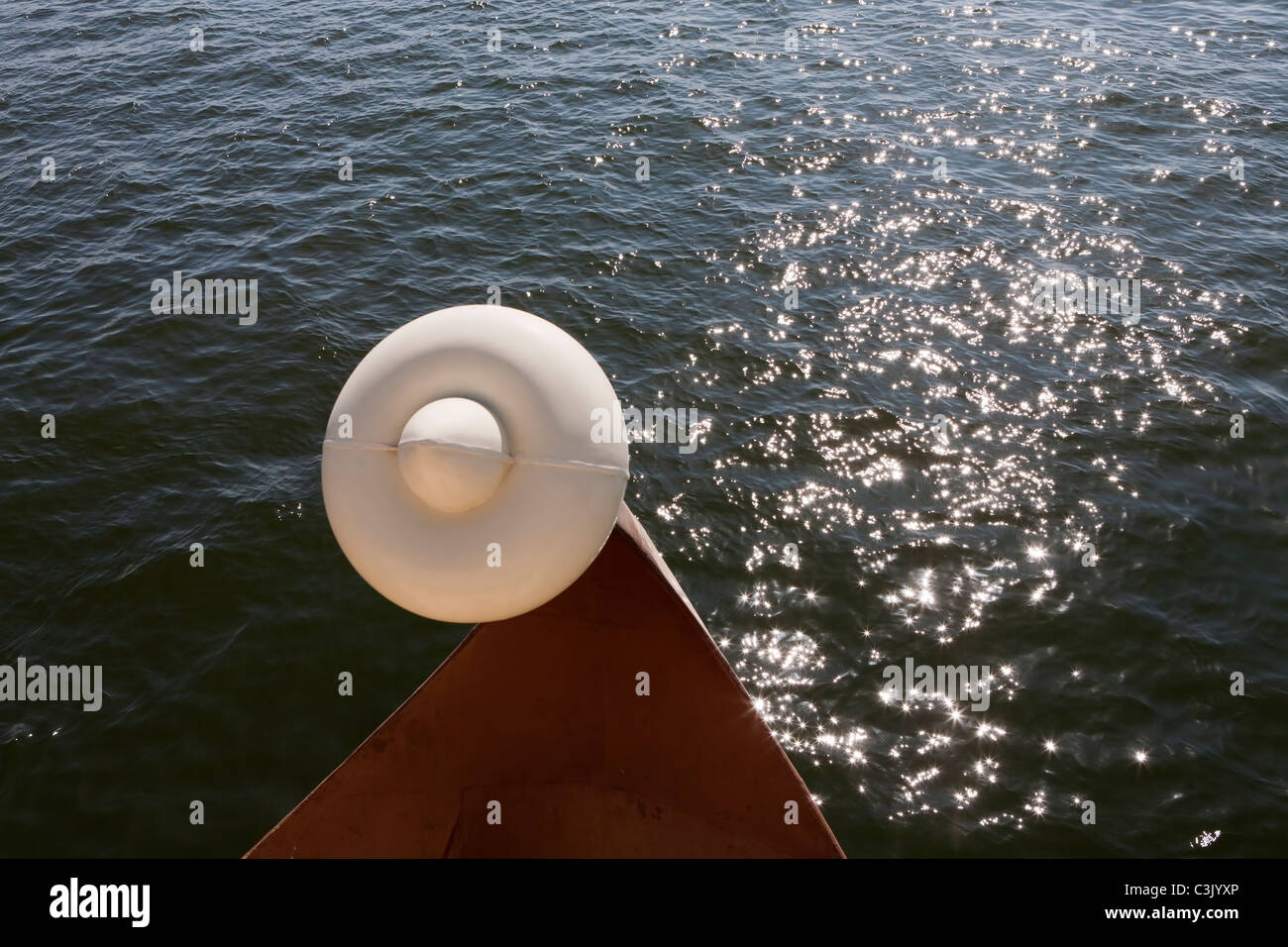 A detail of the prow of the local Luxor Nile ferry against sparkling river water, Egypt, Africa - Stock Image
