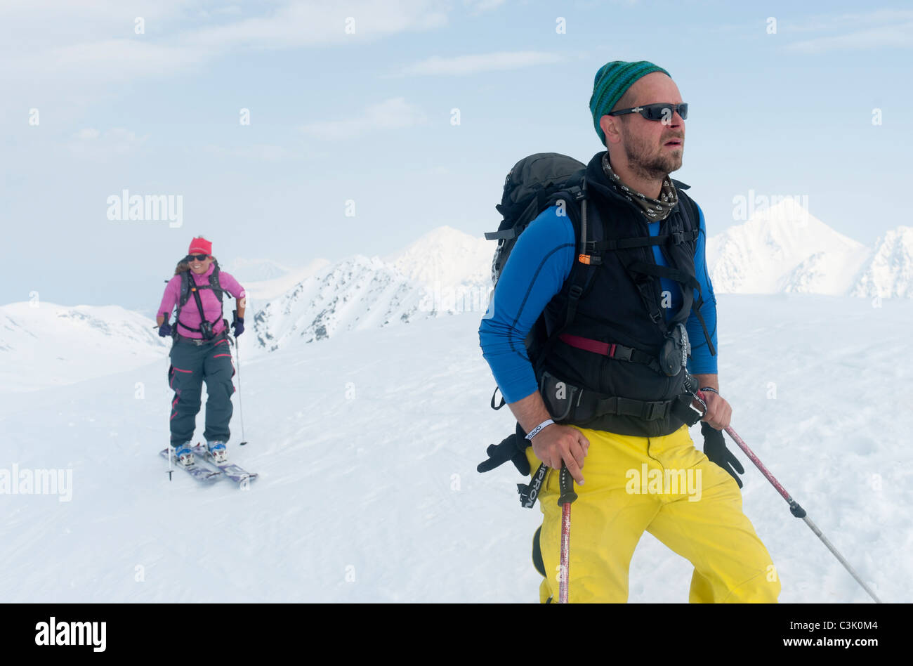 A couple ski-touring in the Lyngen Alps, northern Norway Stock Photo