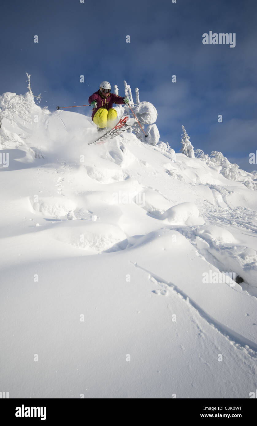 A young man off-piste skiing in Isosyöte, Finland - Stock Image
