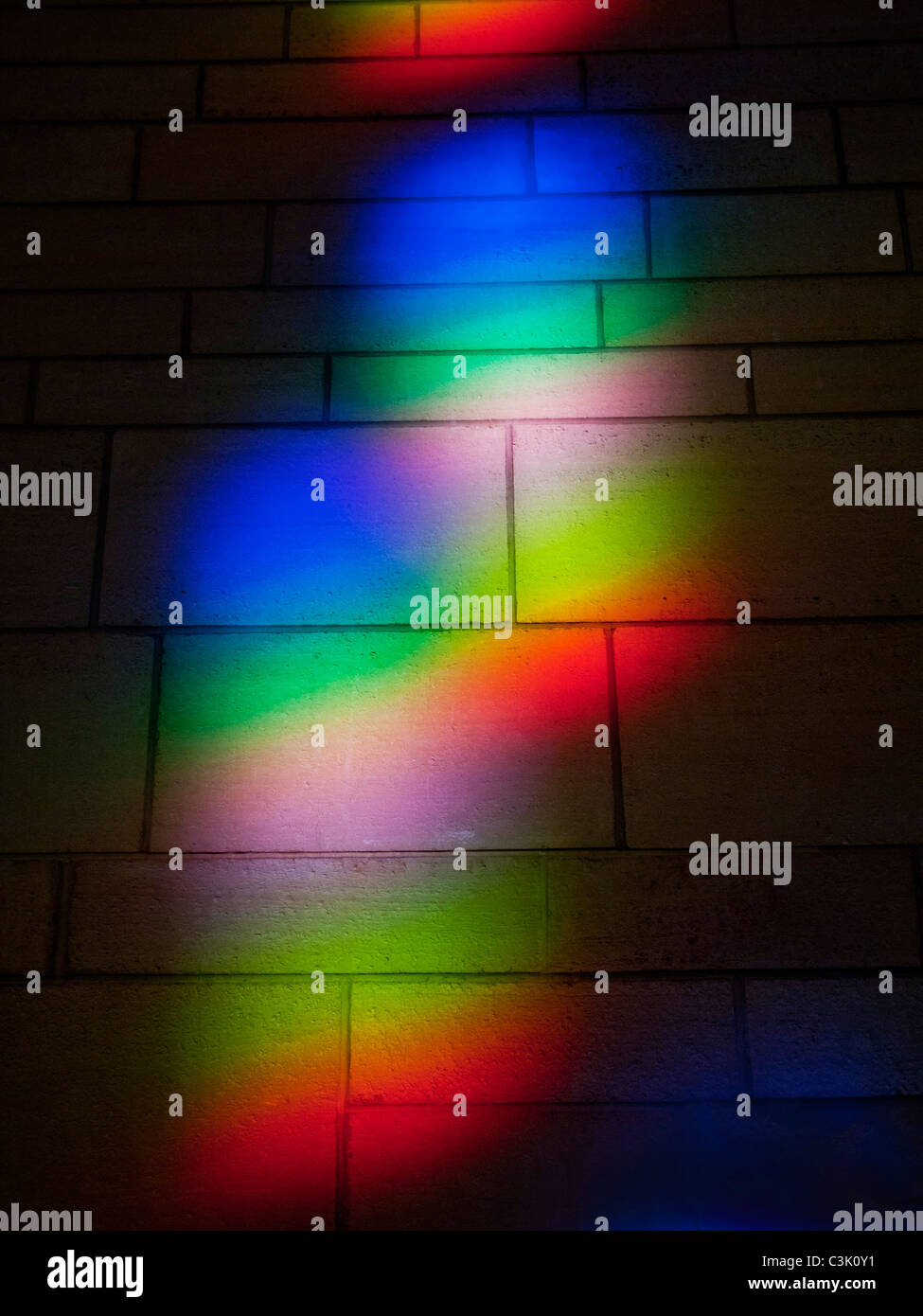 Sunlight refracted through a window forms a spectrum on a wall in Washington, D.C. - Stock Image