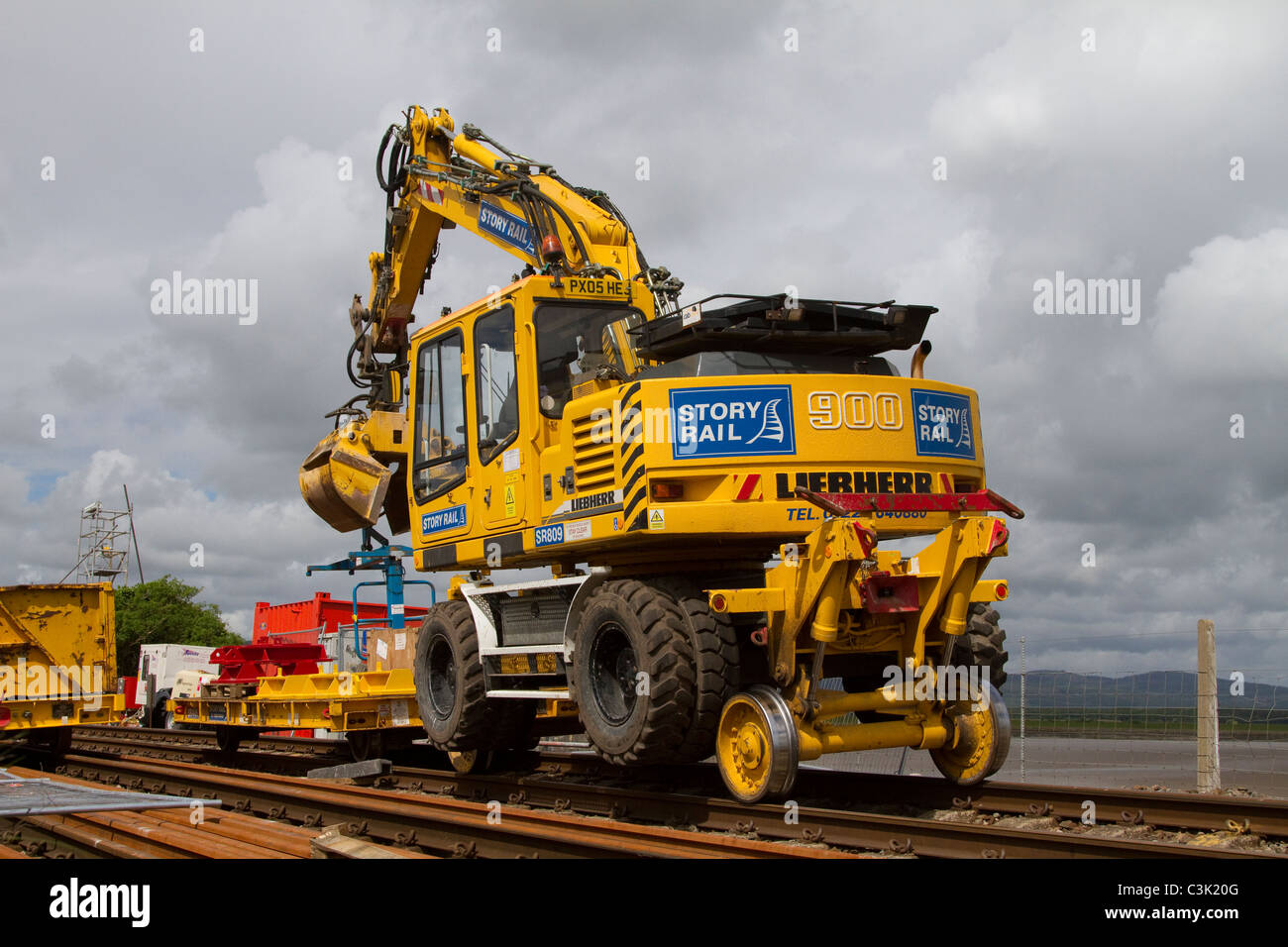 Story Rail _Liebherr A 900 C ZW Hydraulic Excavator Track renewals to Arnside 150-year-old rail viaduct, Cumbria, - Stock Image